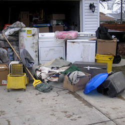 Soaked, wet personal items sitting in a driveway, including a washer and dryer in Dalton.